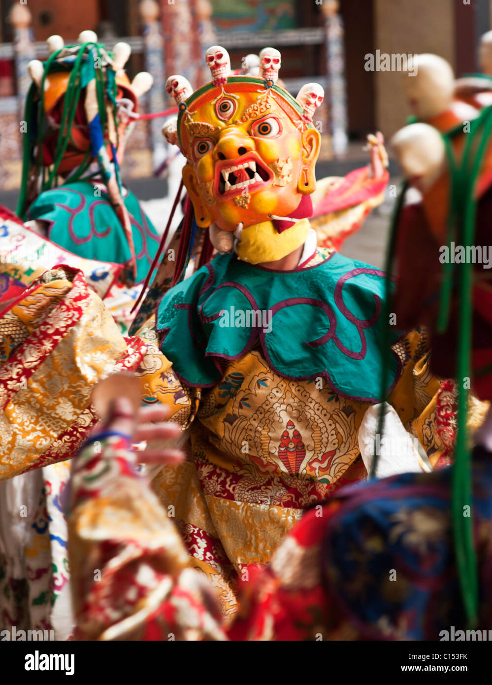 Masked and costumed monastic dancer at a festival in the Trongsa dzong in central Bhutan. - Stock Image