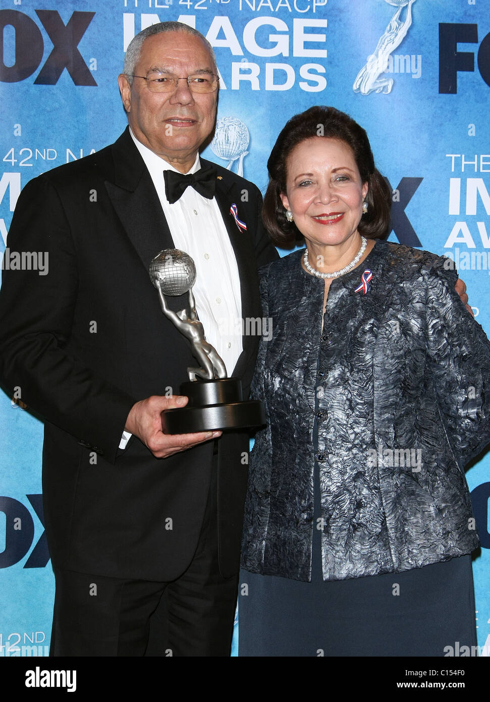 GENERAL COLIN POWELL ALMA POWELL 42ND NAACP IMAGE AWARDS PRESSROOM. DOWNTOWN LOS ANGELES CALIFORNIA USA 04 March - Stock Image