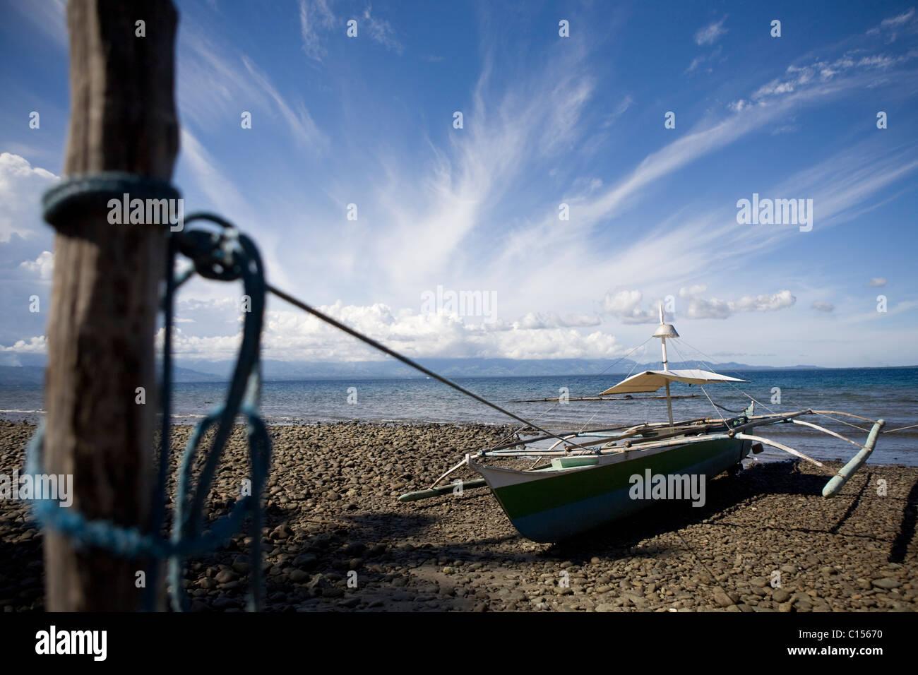 Fishing boat on coastline of Mindenao - Stock Image