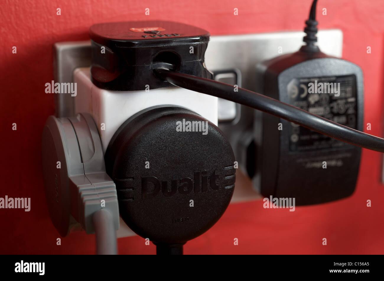 Overloaded electrical sockets (UK) Stock Photo