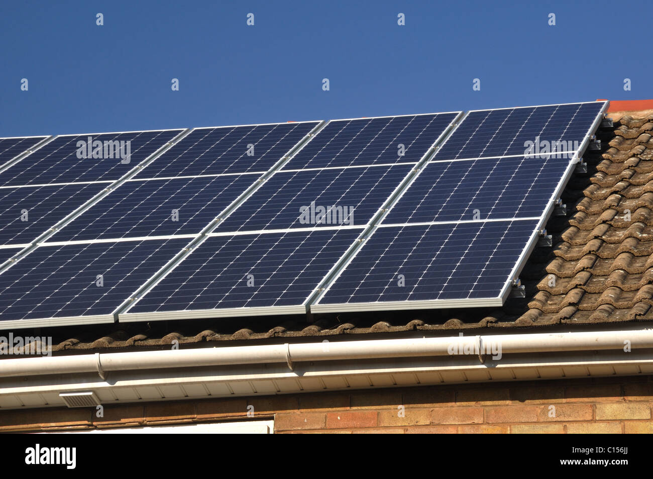Solar Panels on a tiled, pitched roof Stock Photo: 35150378 - Alamy
