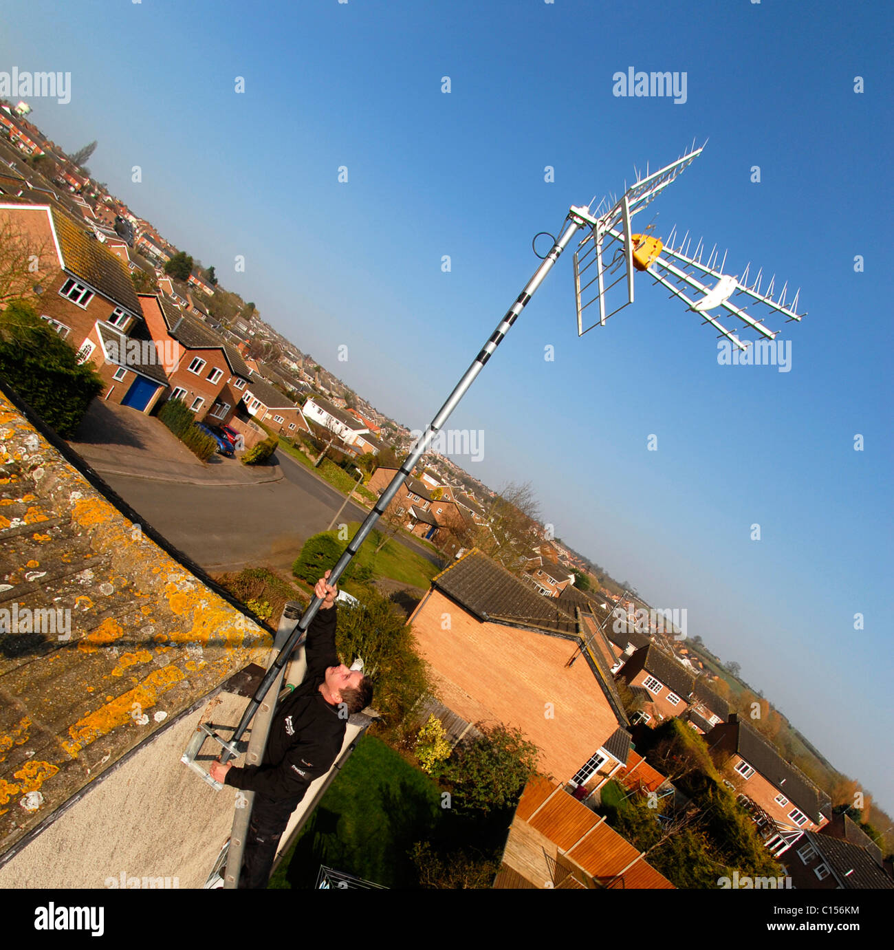 A high gain aerial being fitted to my house in Rothwell, Northants., PHOTO © John Robertson, 2011. - Stock Image