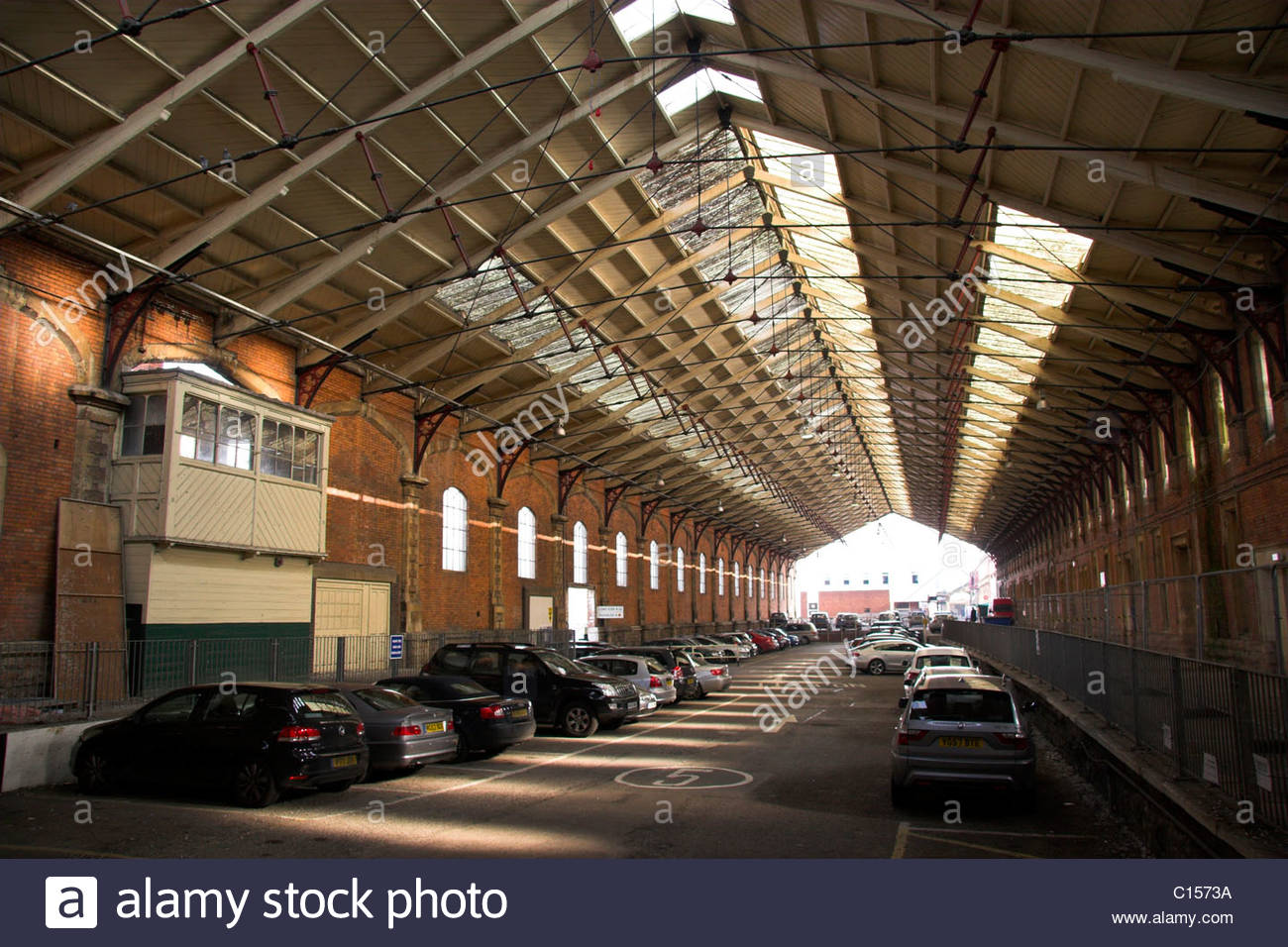 Inside the original Temple Meads railway station, the extended train shed section with the old signal box visible, Stock Photo