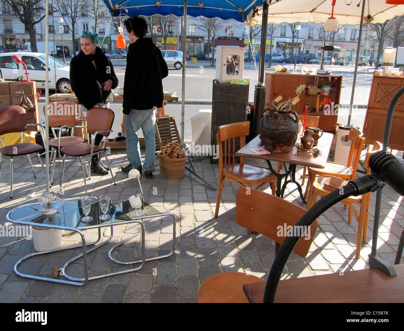 Paris france people shopping in french flea market inexpensive modern furniture