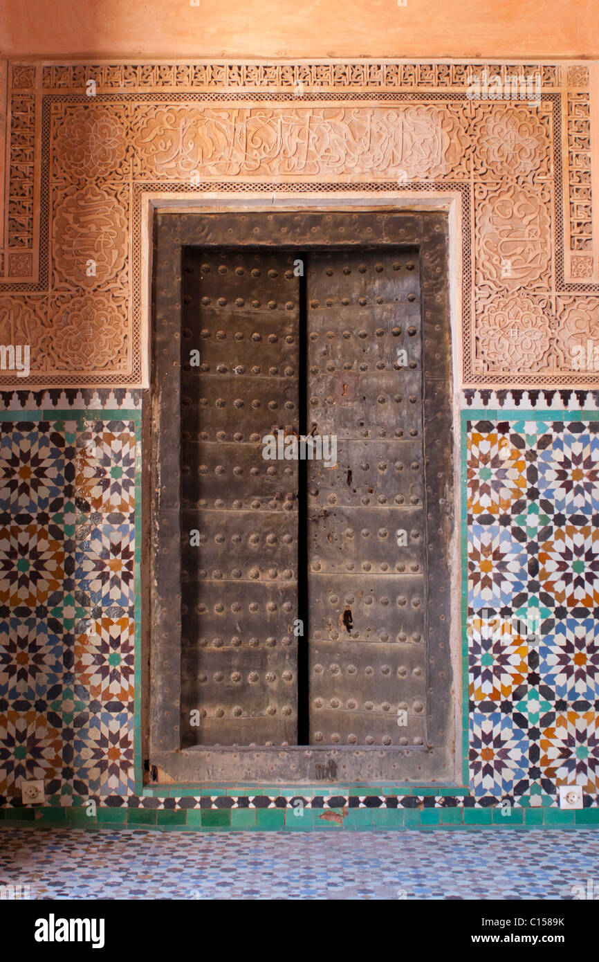 Ancient doorway with patterned tiles in Marrakech - Stock Image