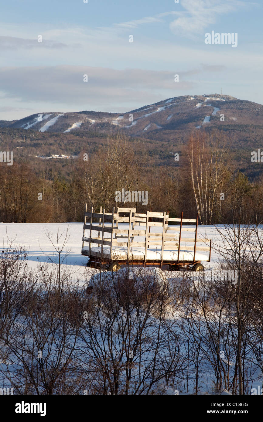 wooden wagon in snowy field, ski slopes in winter, mount sunapee ski