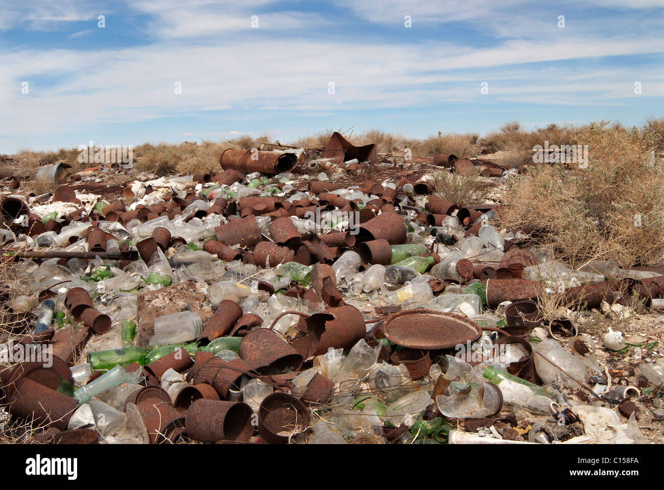 Rusty cans, broken glass filling the landfill. - Stock Image