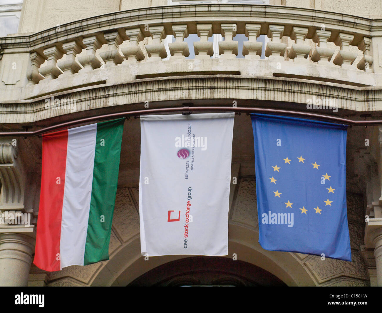 Flags hang over the entrance to the Budapest Stock Exchange. Budapest, Hungary. - Stock Image