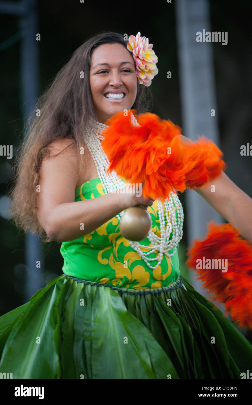 Traditional kahiko hula dancer with uli uli at hula performance in Kona, Hawaii. (MR) - Stock Image