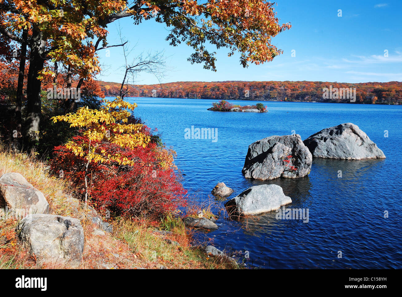 Autumn Mountain with lake view and colorful foliage in forest. - Stock Image