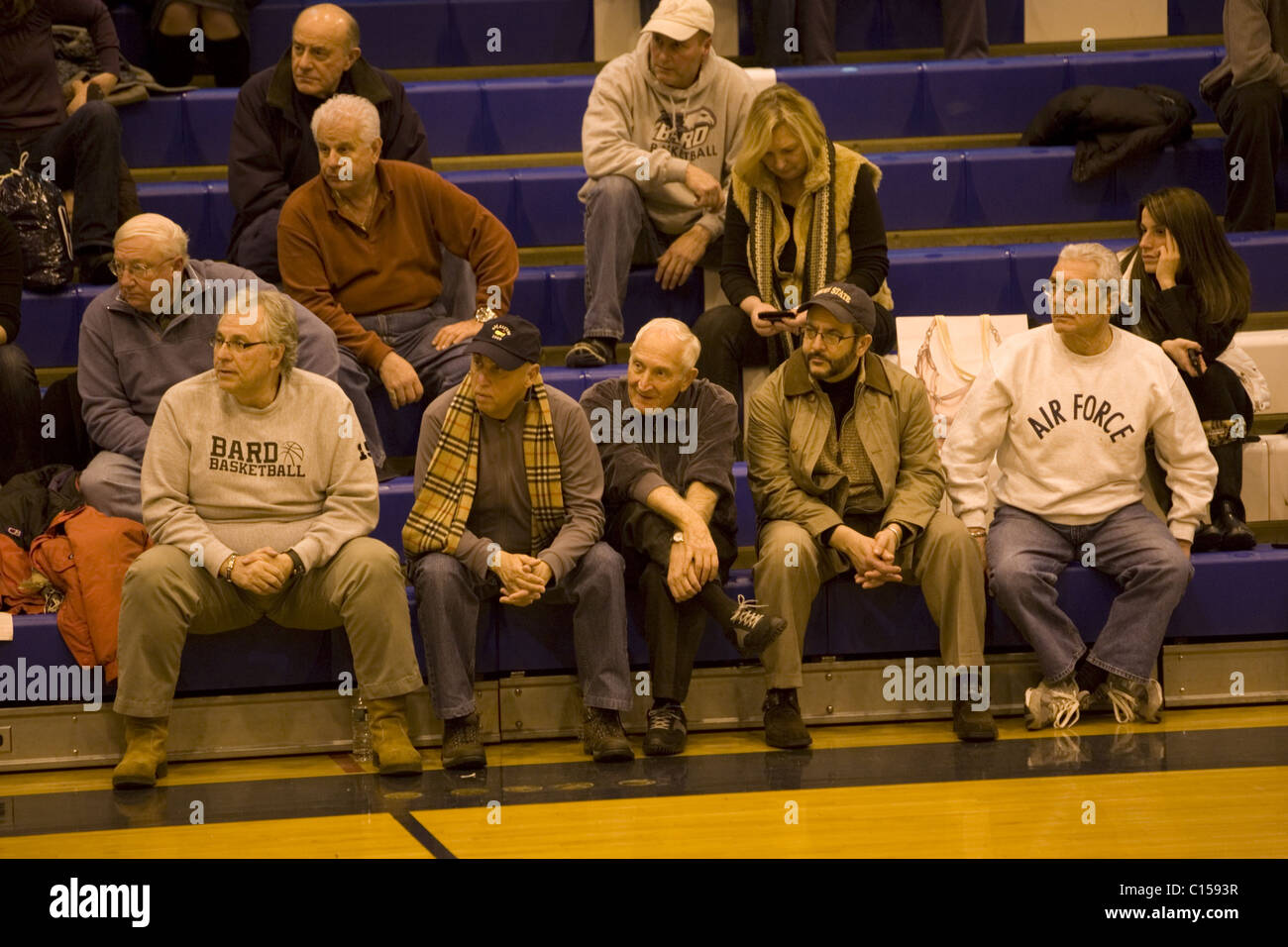 Older alumni from Bard College watch their college basketball team play and lose to Yeshiva University in NYC. - Stock Image