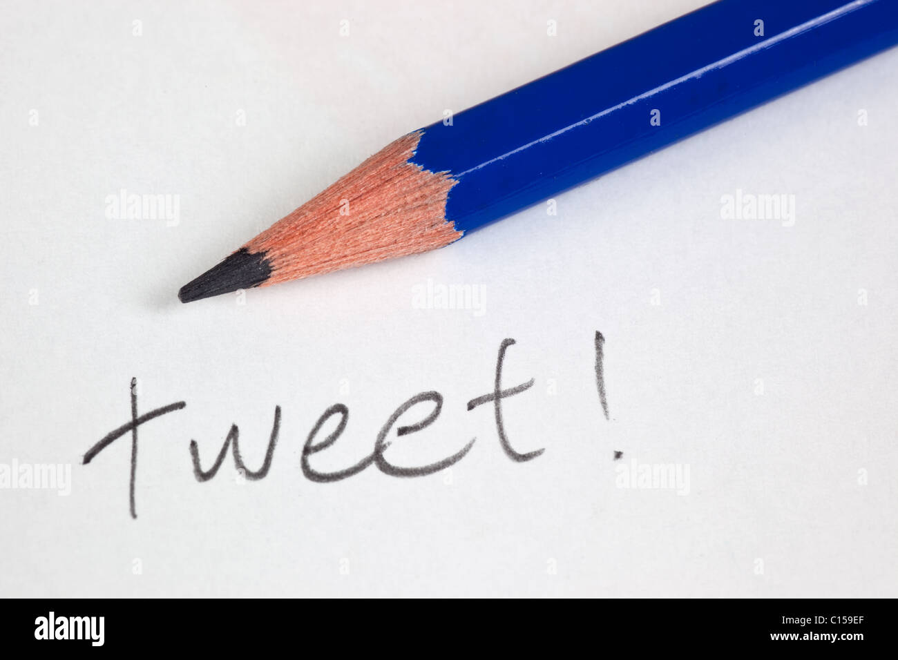 Pencil with the word TWEET on a piece of paper - Stock Image