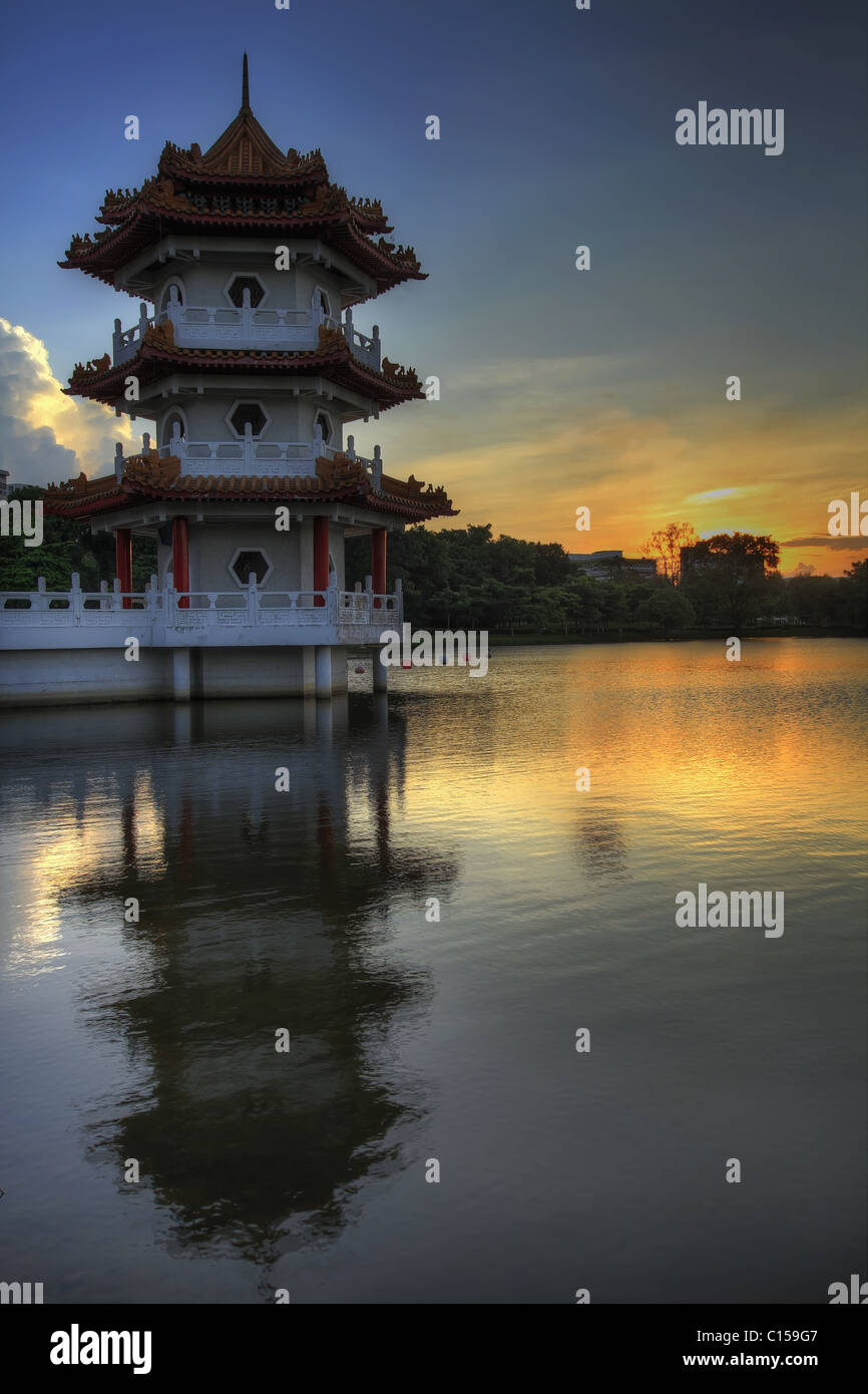 Sunset at Singapore Chinese Garden by Pagoda on the Lake - Stock Image