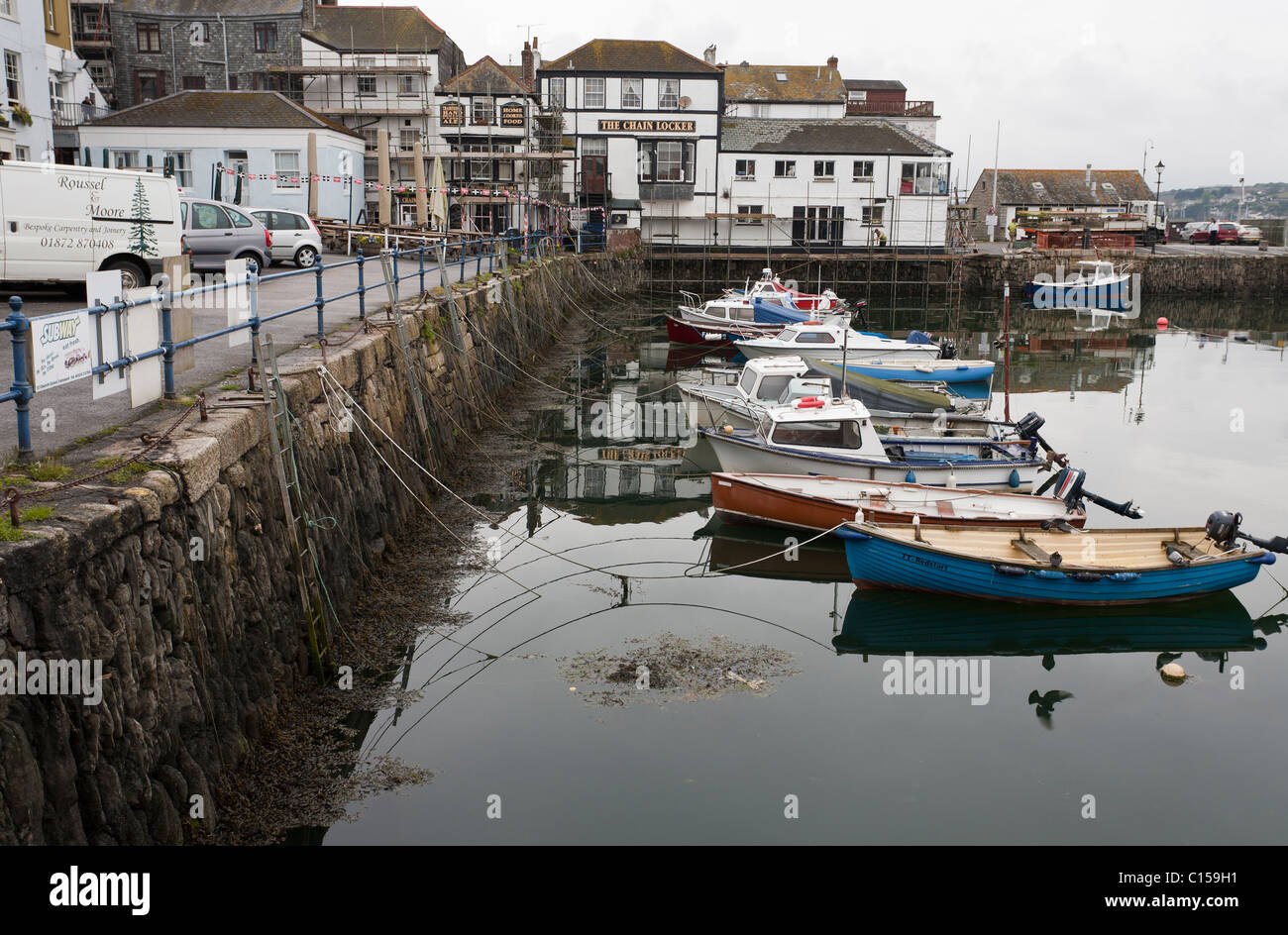 Small Boat Harbour at Falmouth. Small fishing boats tied up to the government dock at the inner harbour of Falmouth. - Stock Image