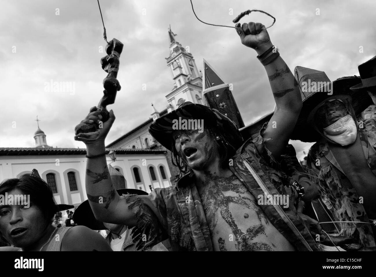 Indians, wearing military camouflage, dance furiously during the Inti Raymi (San Juan) festivities in Cotacachi, - Stock Image