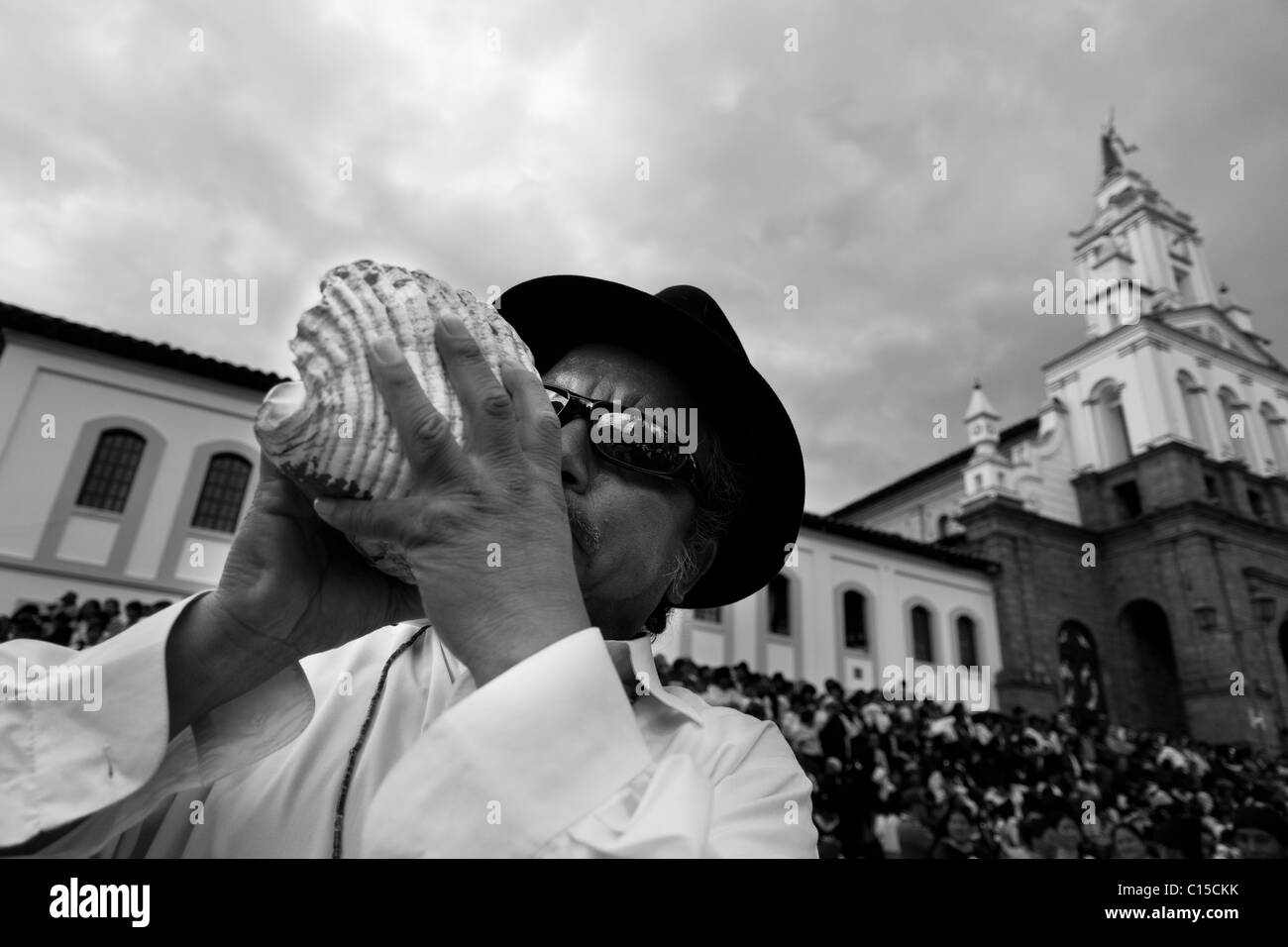 An Indian blows a shell trumpet during the Inti Raymi (San Juan) festivities in Cotacachi, Ecuador. - Stock Image