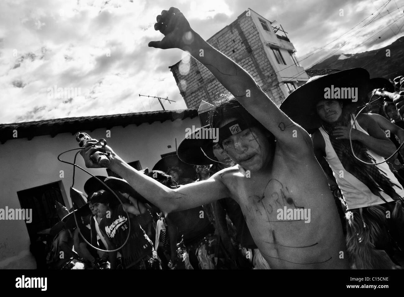Indians dance furiously during the Inti Raymi (San Juan) festivities in Cotacachi, Ecuador. Stock Photo