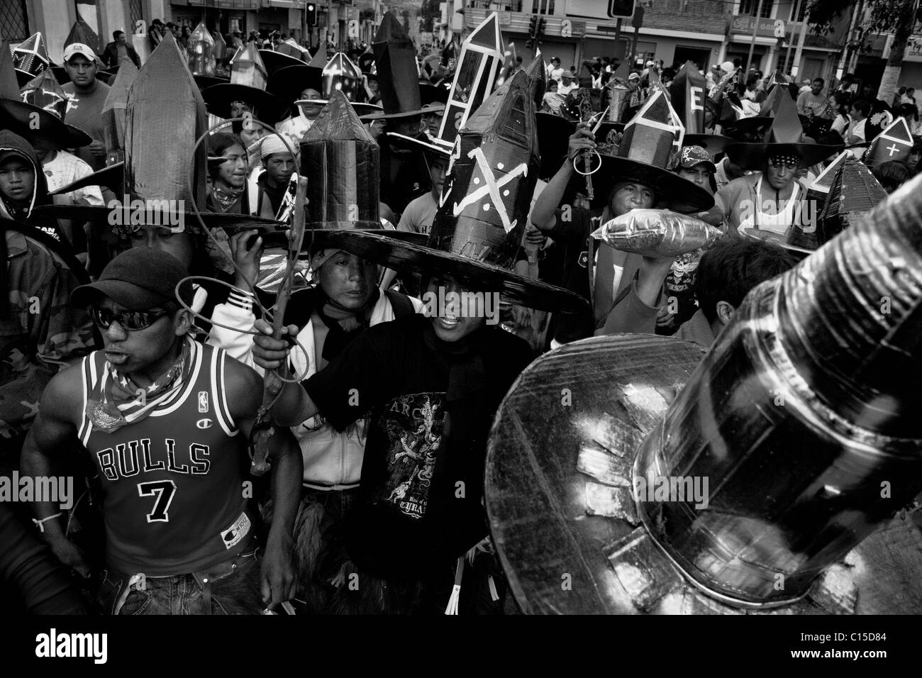 Indians, wearing black cardboard hats, dance and shout violently during the Inti Raymi festivities in Cotacachi, - Stock Image