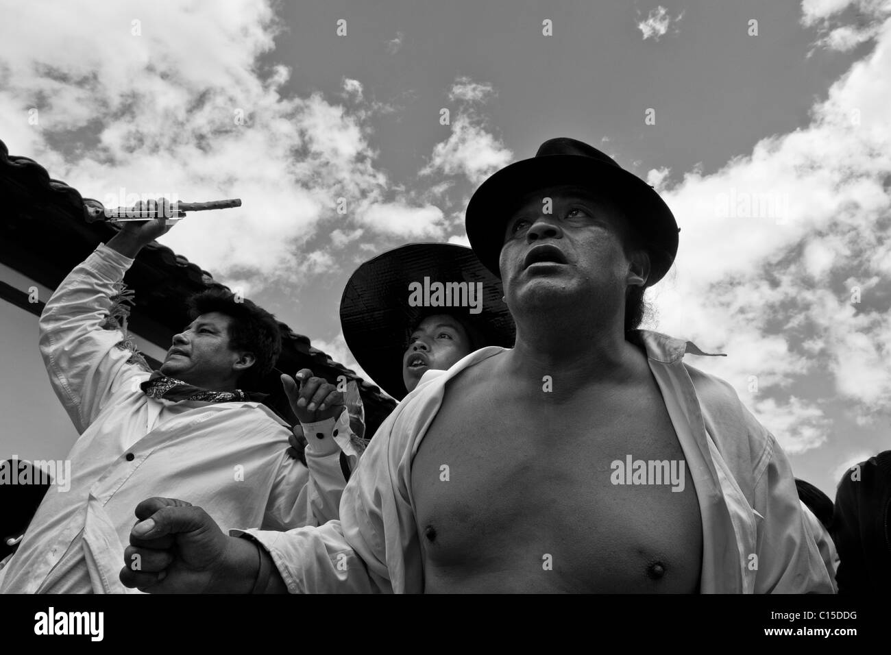 Indians, wearing white shirts, dance and shout during the Inti Raymi (San Juan) festivities in Cotacachi, Ecuador. - Stock Image