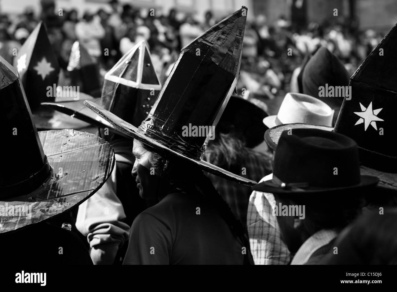 Indians, wearing black cardboard hats, dance during the Inti Raymi (San Juan) festivities in Cotacachi, Ecuador. - Stock Image