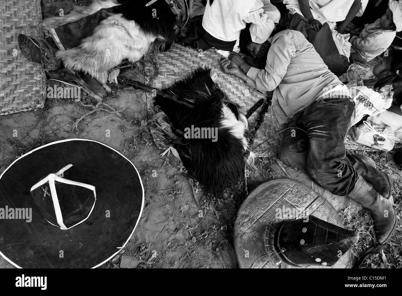 Indians, having their cardboard hats off, sleep on the floor during the Inti Raymi (San Juan) festivities in Cotacachi, - Stock Image