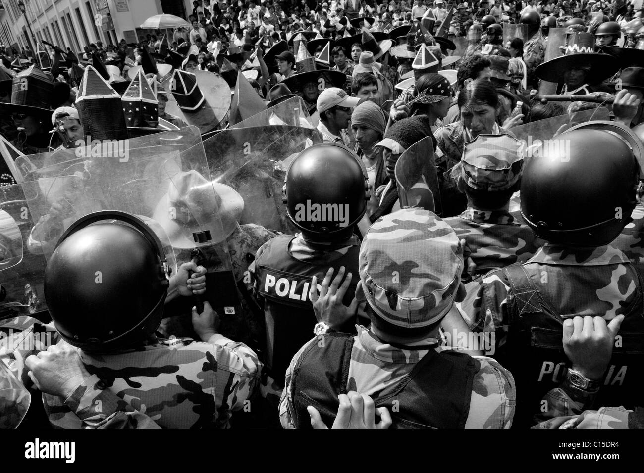 Indians clash with the riot police block during the Inti Raymi (San Juan) festivities in Cotacachi, Ecuador. Stock Photo