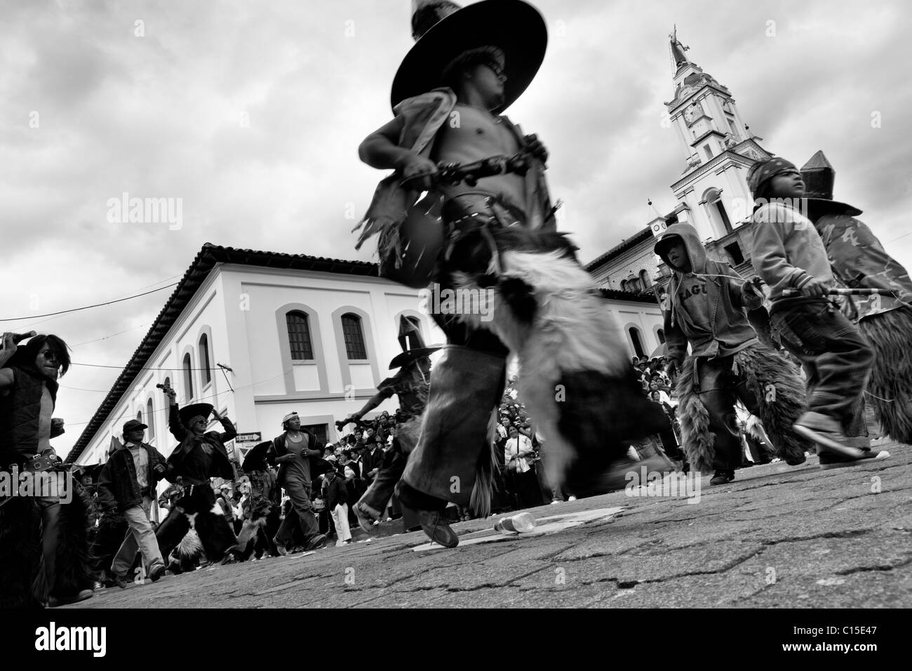 Indians, wearing goatskin chaps, dance furiously during the Inti Raymi festivities in front of the church in Cotacachi, - Stock Image