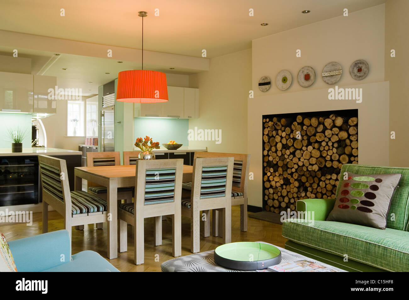Large orange lampshade above dining table in open plan kitchen room large orange lampshade above dining table in open plan kitchen room with firewood aloadofball