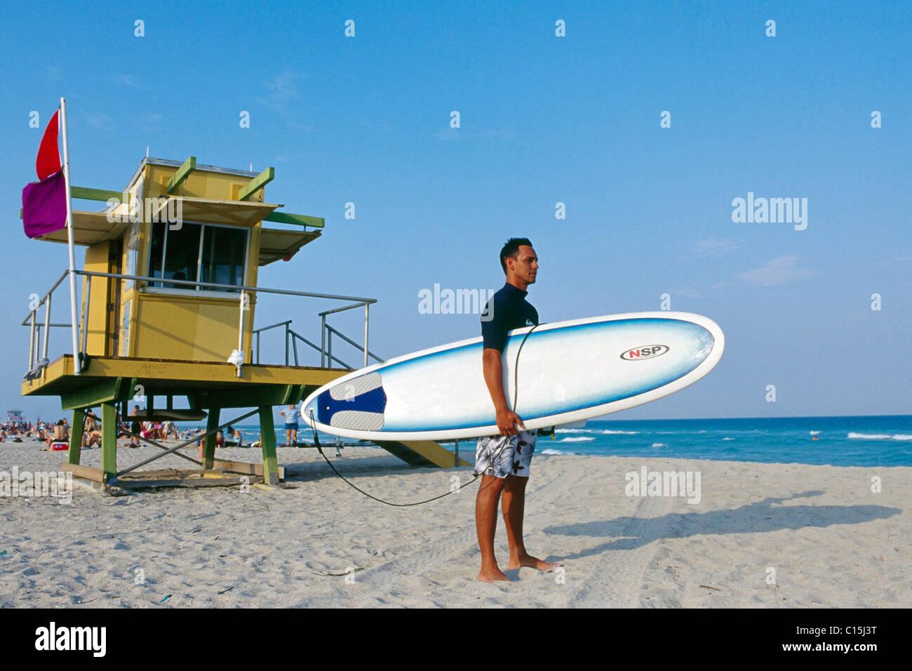 Surfer with his board under his arm, South Beach, Miami Beach, Miami, Florida, USA - Stock Image