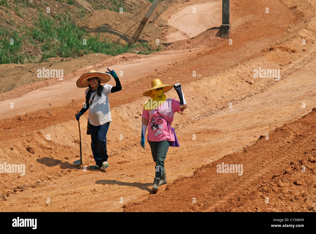 Lady labourers at road works,Chiang Saen,Thailand,on new highway to Mekong river. - Stock Image