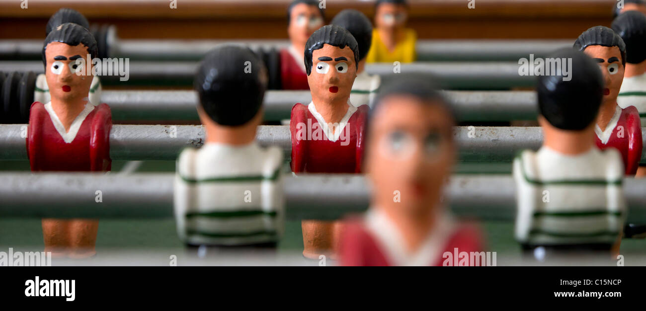 Suspicious player on a table football game conceptual - Stock Image