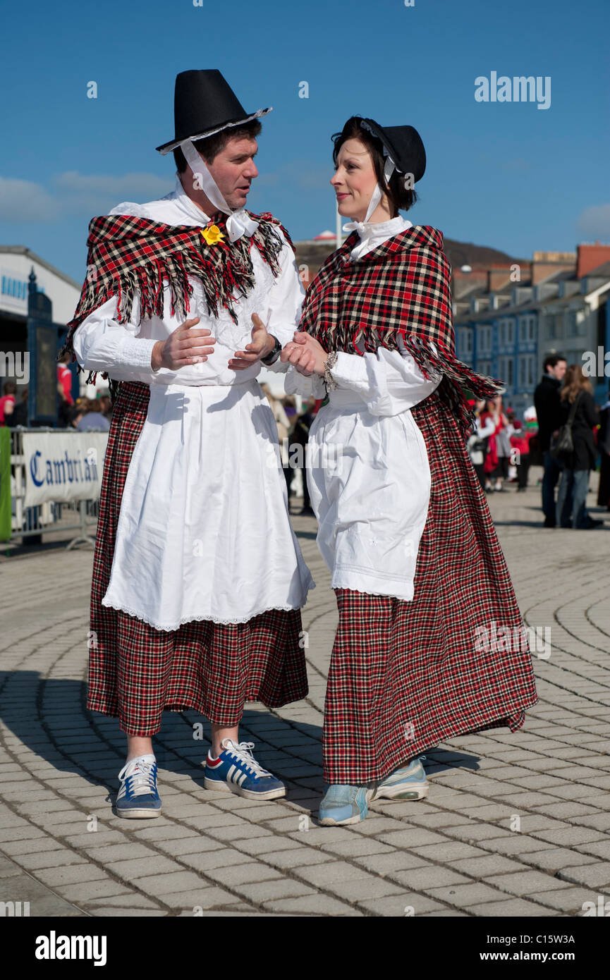 9aed3a934 St Davids Day Wales UK - a man and woman both dressed in traditional womans  plaid