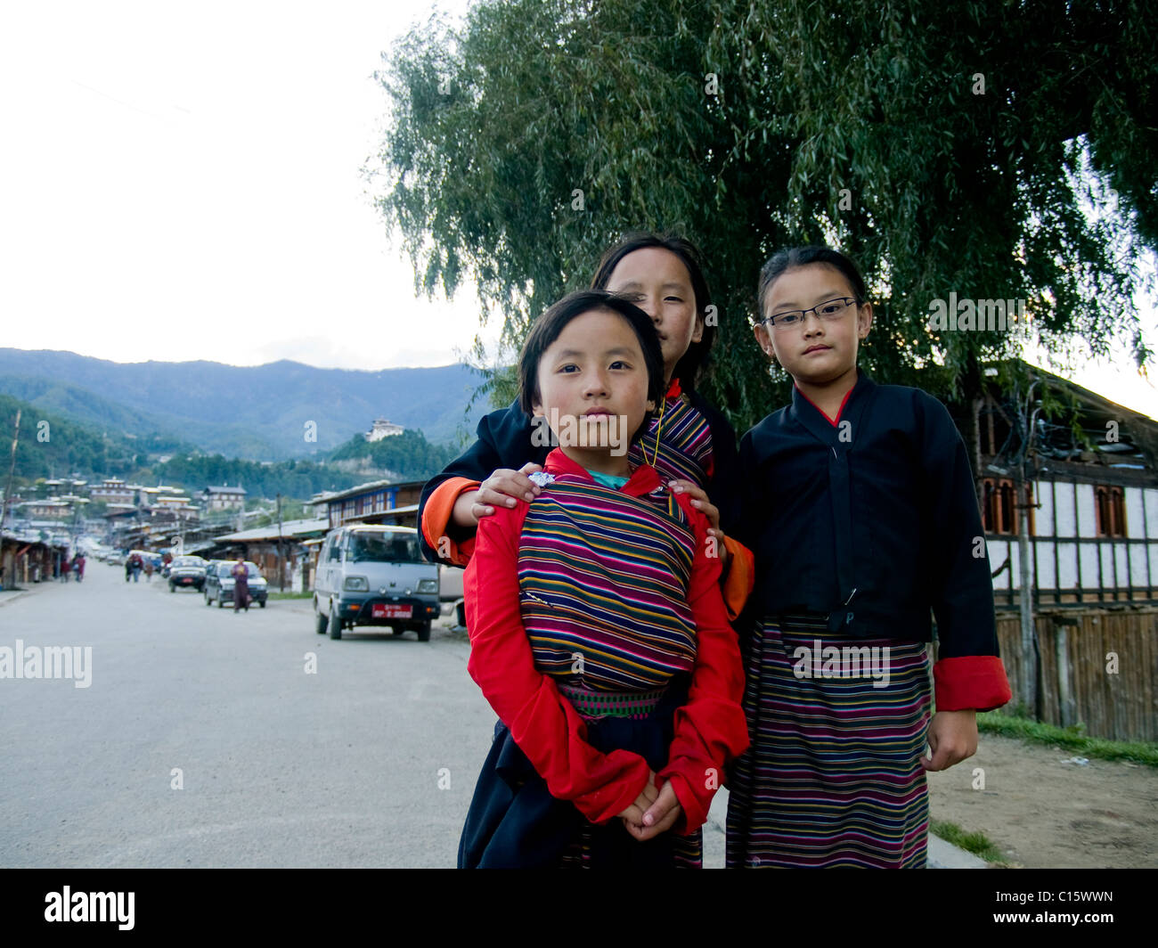 Young girls wearing traditional Kira dresses in Bumthang, Bhutan - Stock Image