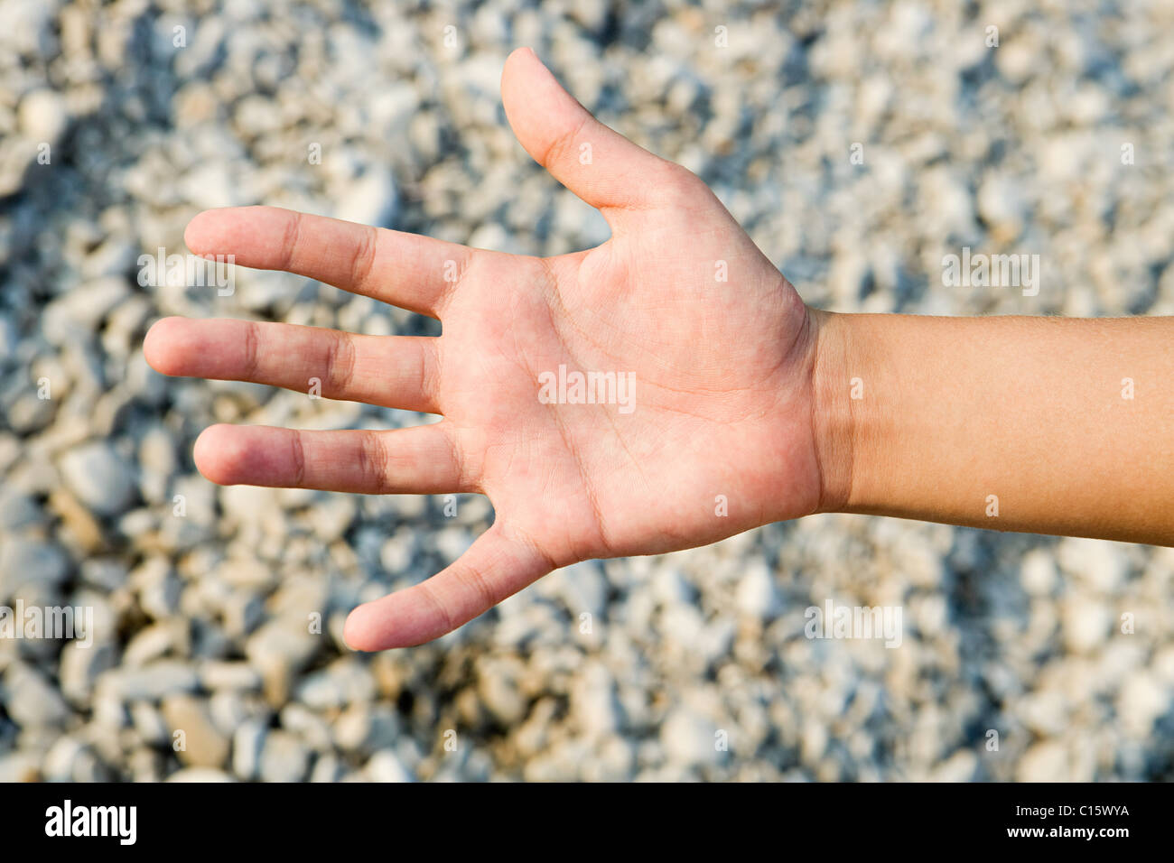 Person's palm against textured background - Stock Image
