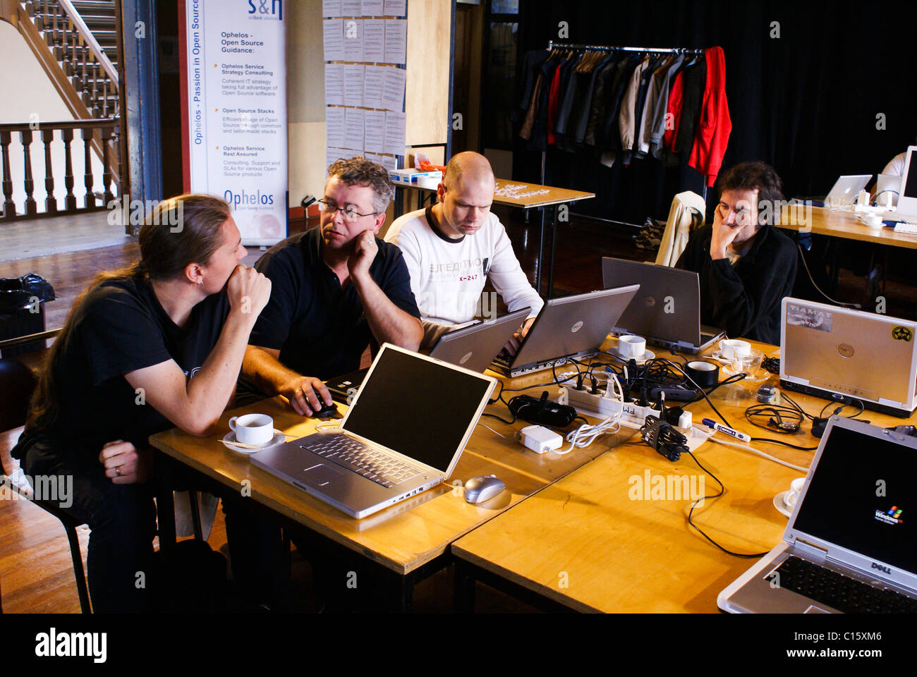 Open source software developers working together at a 'hackathon' meetup. - Stock Image