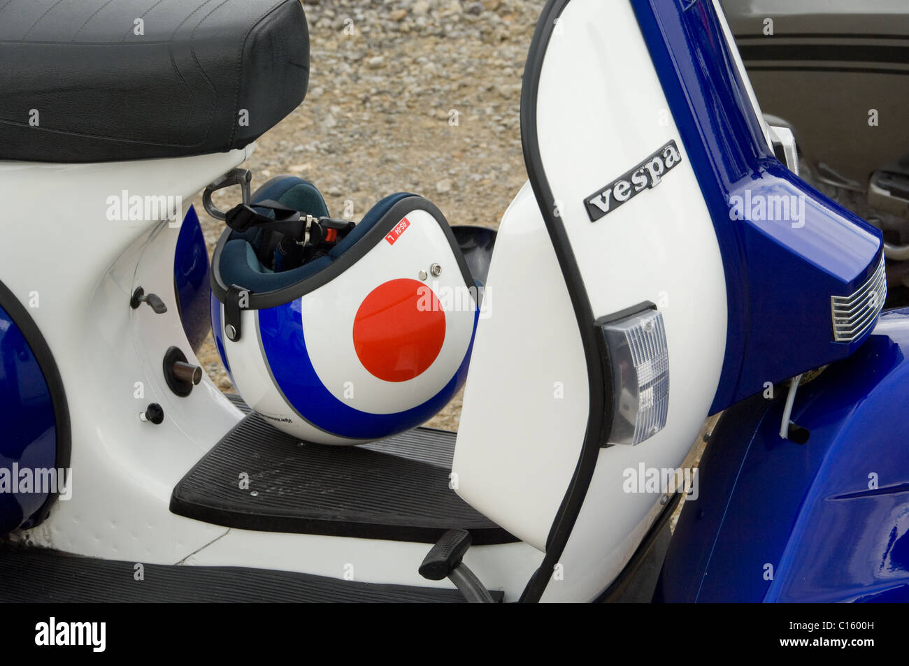Blue and white Vespa scooter & helmet - Stock Image
