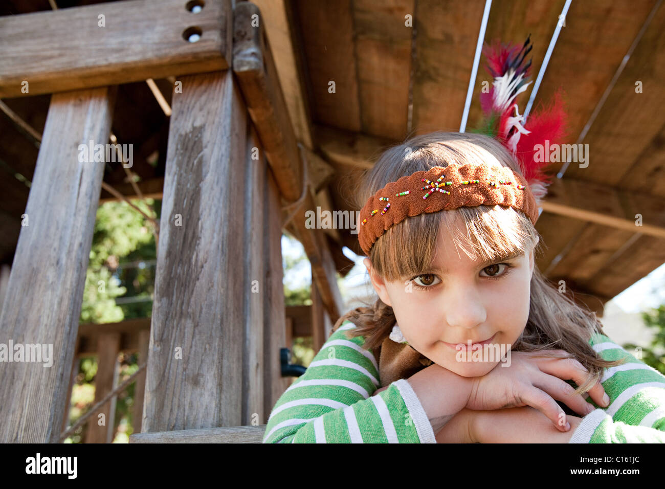 Girl in Native American costume - Stock Image