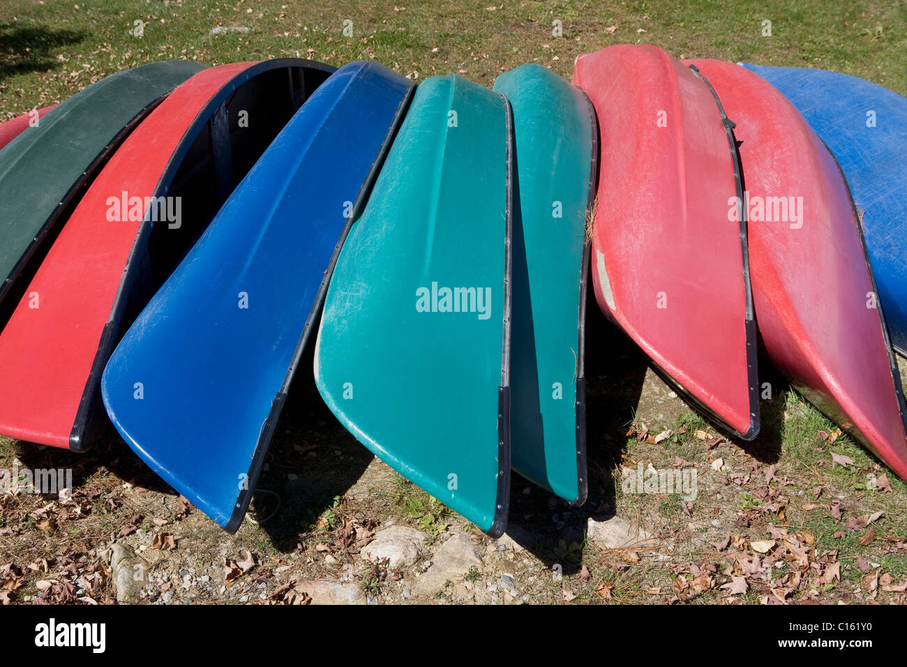 Canoes upside down in a row - Stock Image