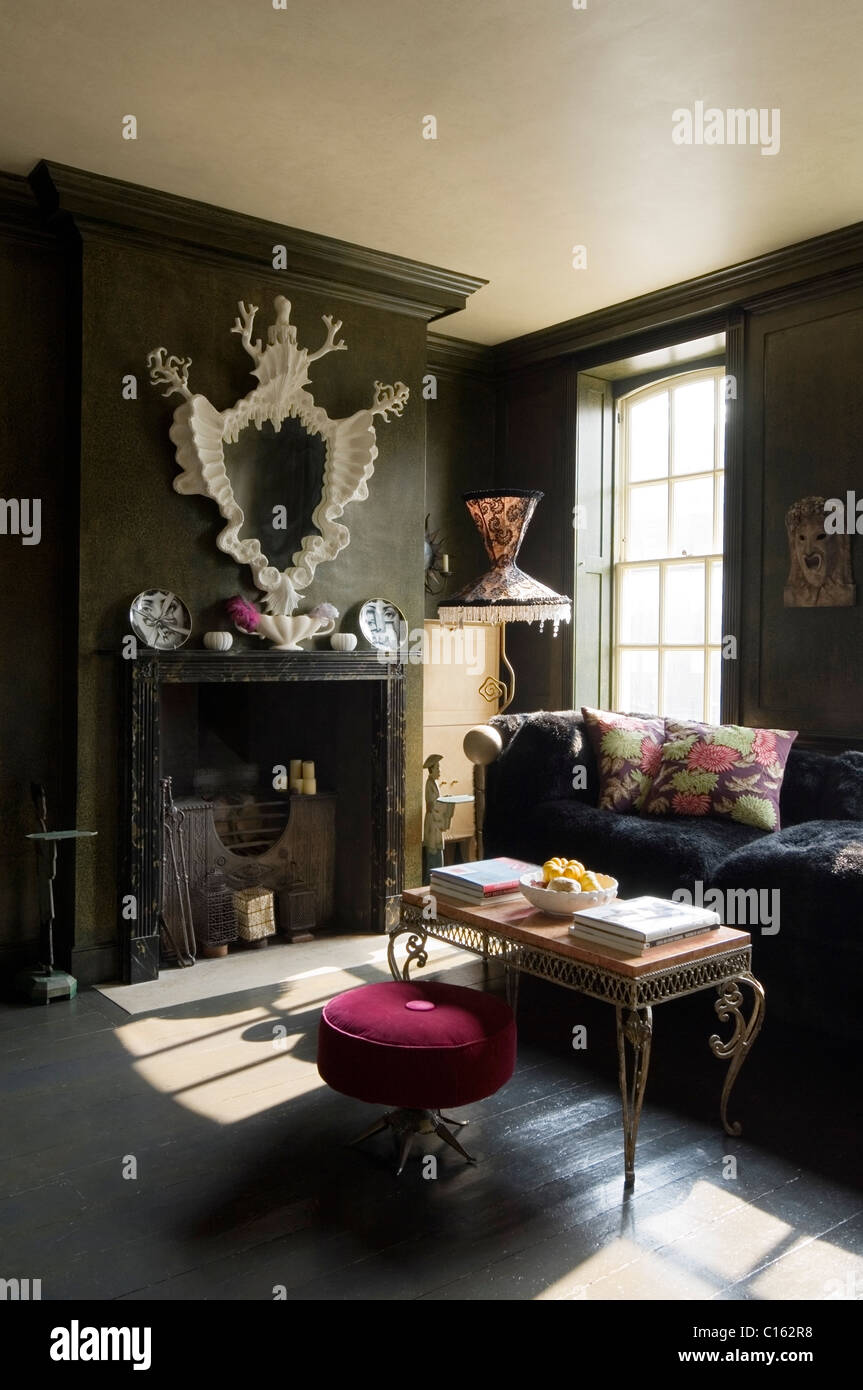 Sculptural Mirror Above Fireplace In Green Walled Living Room With Andre Arbus  Furniture