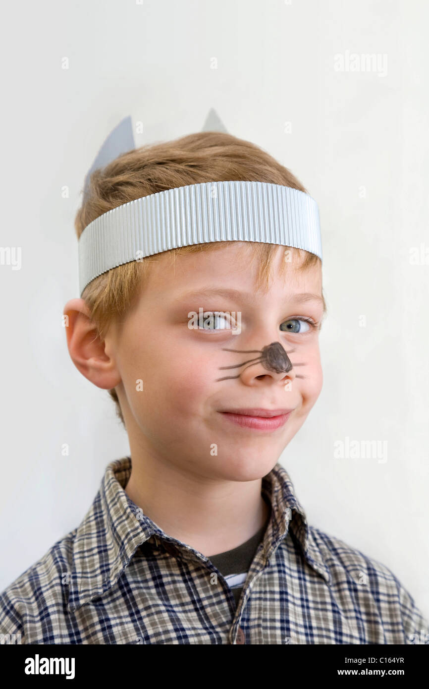 Boy, six years of age, face painted to look like a mouse - Stock Image
