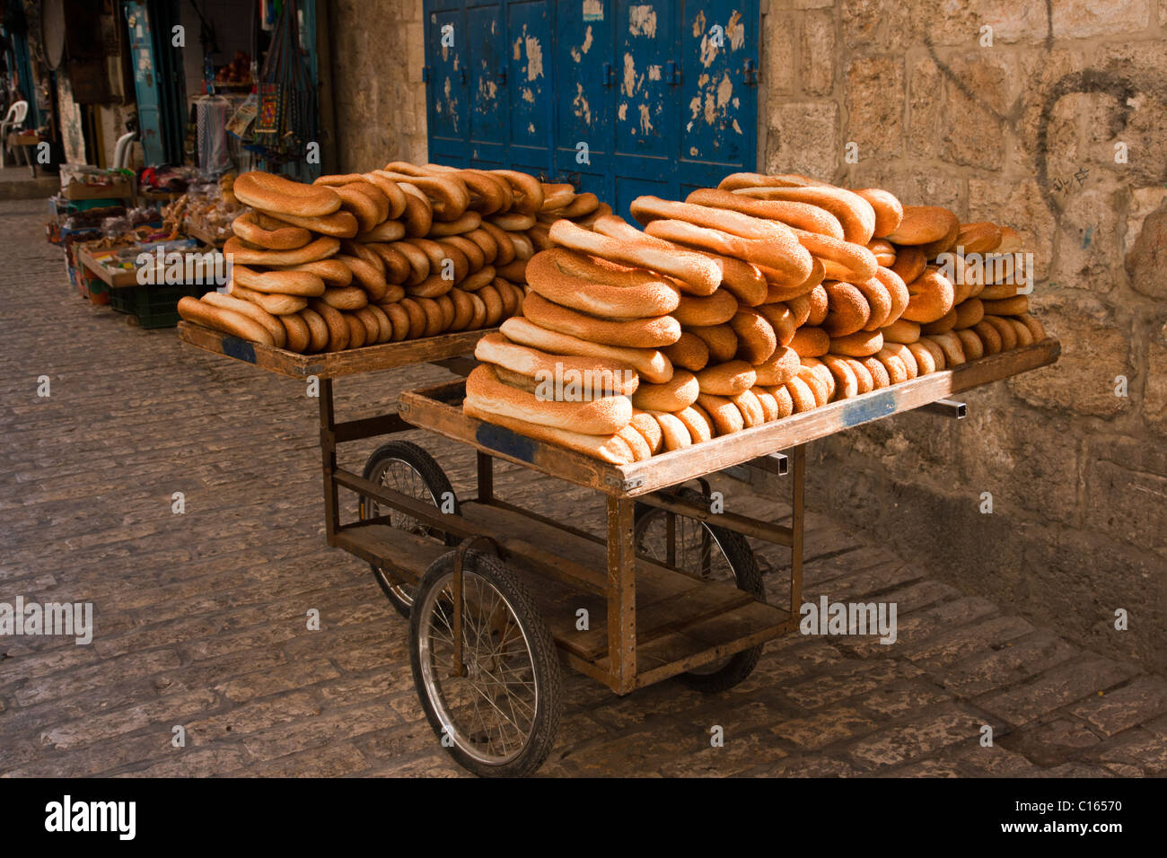 Cart of bread in the streets of Old Jerusalem. - Stock Image
