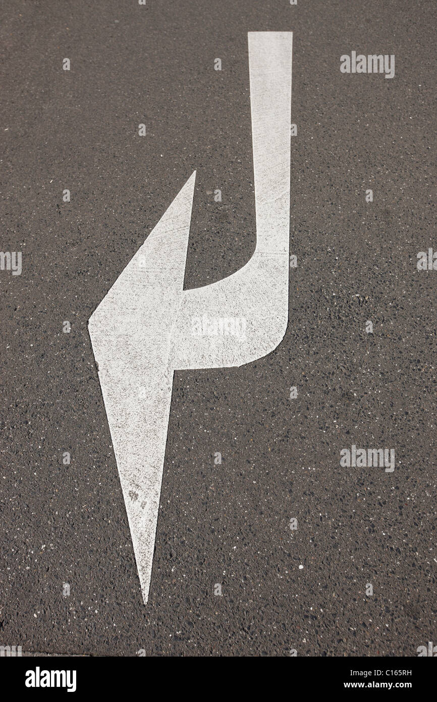 Arrow on a street, Germany, Europe - Stock Image
