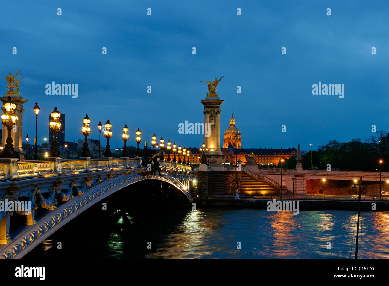 Pont Alexandre III. over the Seine River with the Les Invalides Church, Napoleon's tomb, city centre, Paris, - Stock Image