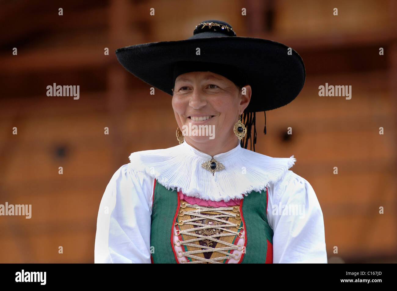 Local woman wearing a traditional costume of the Val Gardena Valley during a traditional procession in the village Stock Photo