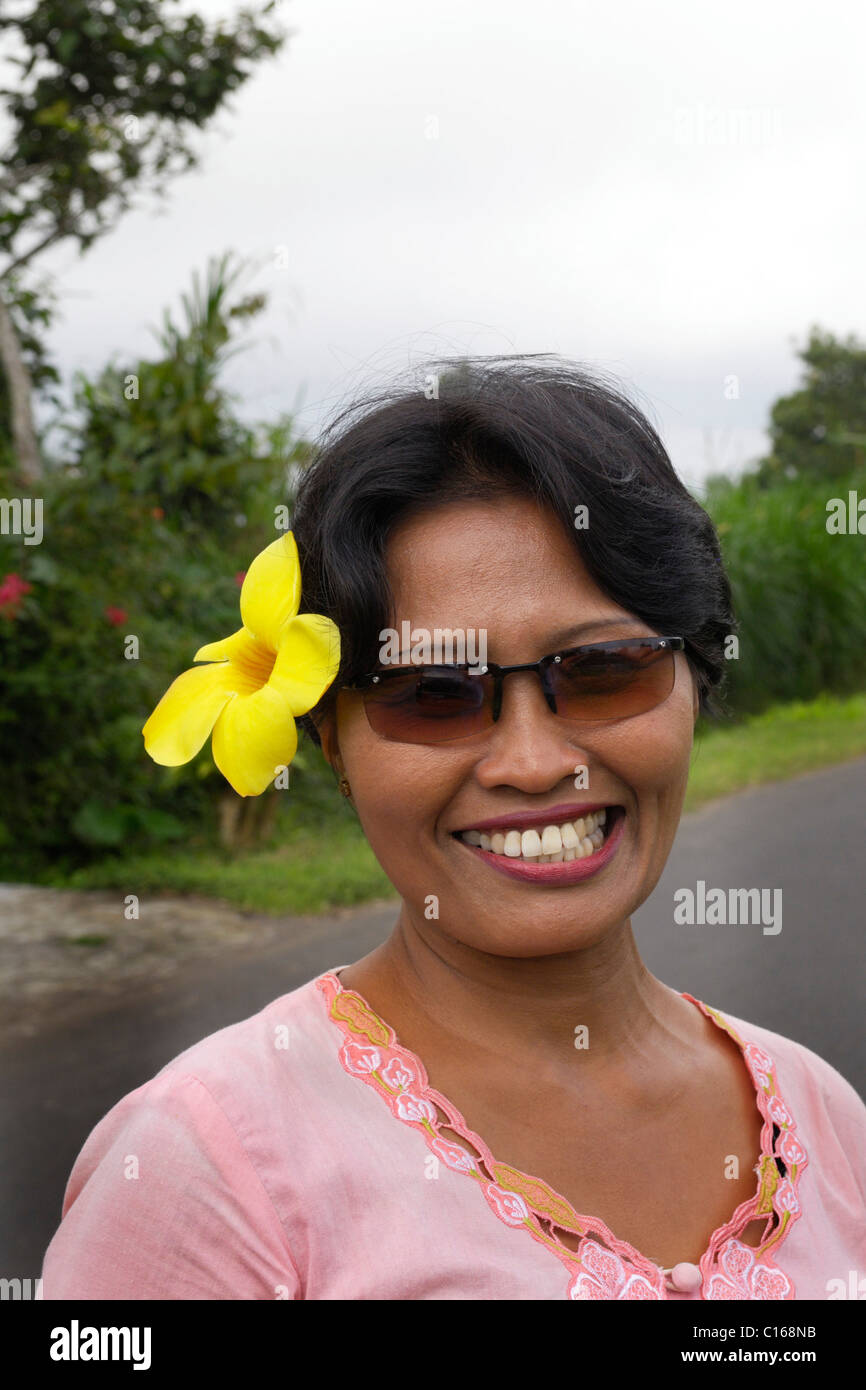Flower behind ear stock photos flower behind ear stock images alamy balinese woman with a yellow flower behind her ear bali indonesia south east izmirmasajfo