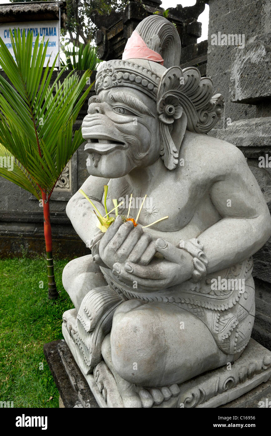 Figure from Balinese mythology near Rendang with an offering, Bali, Indonesia, South East Asia - Stock Image