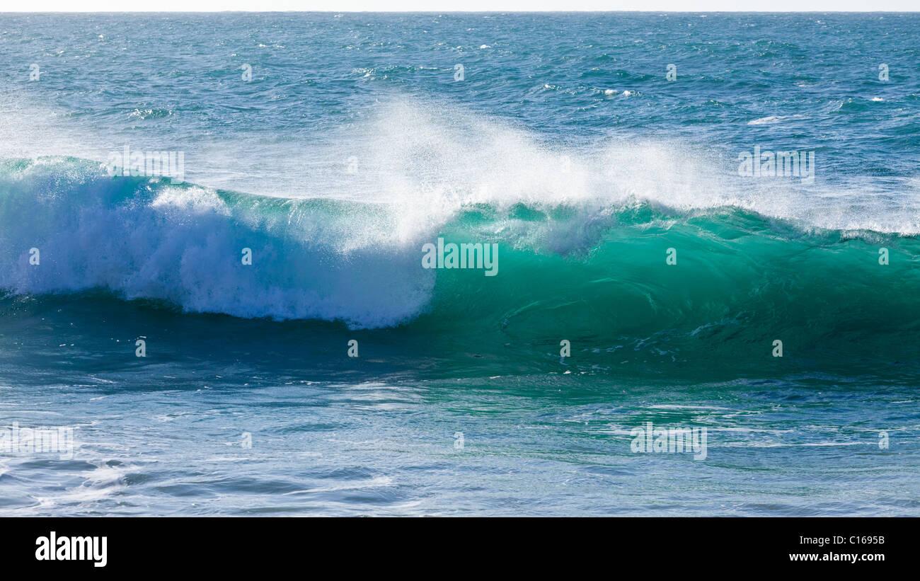 Heavy Atlantic seas with large waves crashing onto the beach at Ajuy on the Canary Island of Fuerteventura - Stock Image