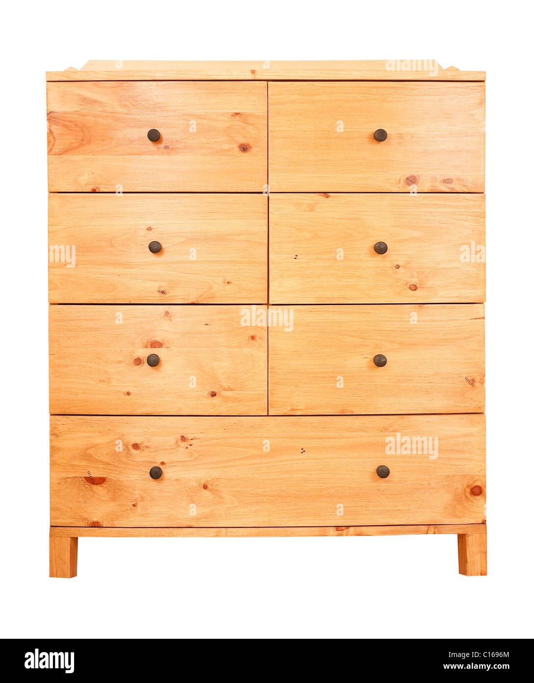 Contemporary pine chest of drawers isolated against a white background with clipping path - Stock Image
