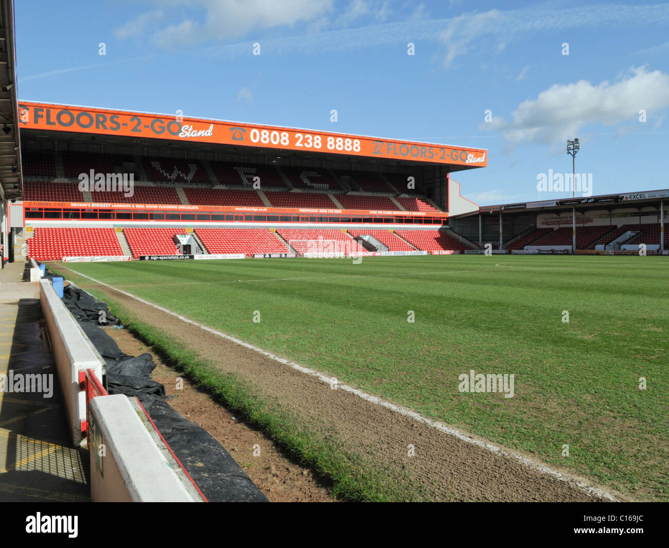 Inside Walsall Football Club's Banks's Stadium looking towards up the pitch towards its Floors-2-Go stand - Stock Image