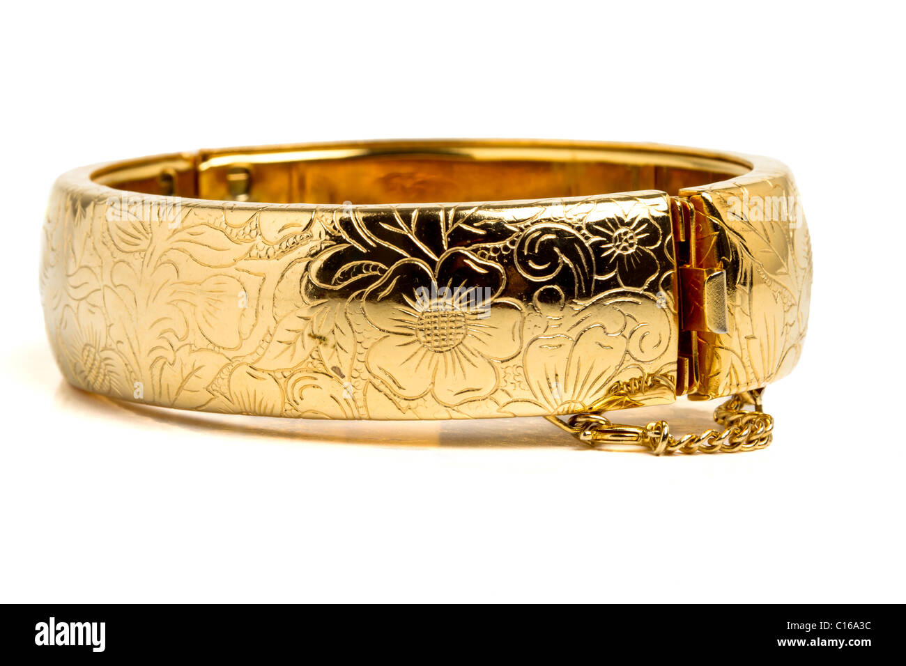 Vintage gold bangle from low perspective isolated on white. - Stock Image